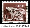 "IRELAND - CIRCA 1968: A stamp printed in Ireland shows a dog from an ancient Brooch, without the inscription, from the series ""Prehistoric art"", circa 1968. - stock photo"