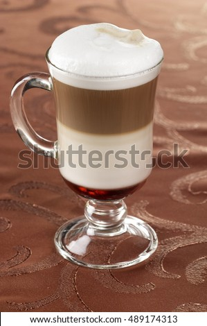 Irish coffee in special glass over fabric