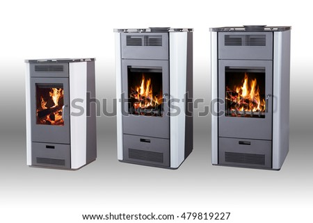 Iron solid fuel stove with burning wood isolated on white background with gray gradient