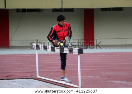 ISLAMABAD - APRIL 24: Athlete warming up during Quaid-e-Azam Inter-Provincial Games being held at the Pakistan Sports Complex in Islamabad, Pakistan