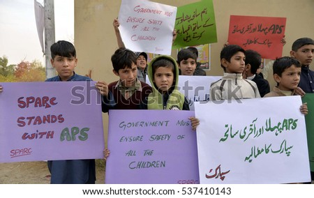 ISLAMABAD, PAKISTAN - DEC 16: Students hold placards during a protest against the  Taliban attack on an army-school to mark is second anniversary, on December 16, 2016 in Islamabad.
