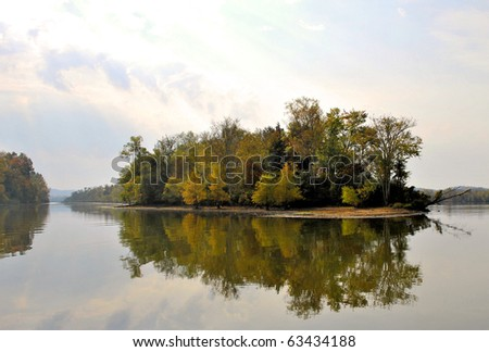 island reflection in the mirror like waters of the Tennessee River (Hiwassee River, Chickamauga Lake)