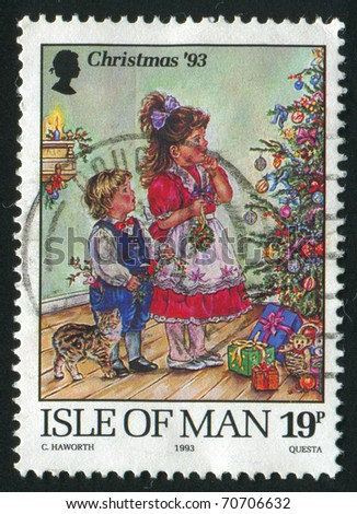 ISLE OF MAN - CIRCA 1993: stamp printed by Isle of Man, shows Children decorating Christmas tree, circa 1993.