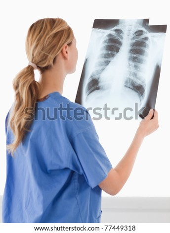 Isolated female doctor looking at an X-ray