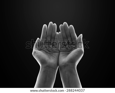 Isolated female empty open human hands with palms raised up in black and white : Pray for spiritual support and helping concept