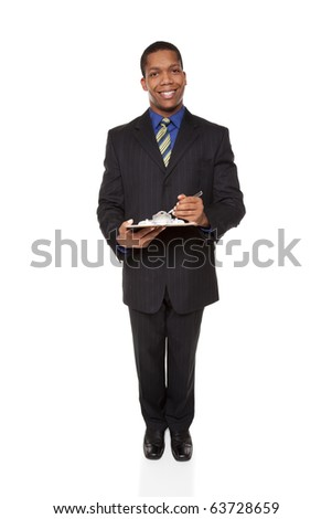 Isolated full length studio shot of a businessman filling out a questionnaire on a clipboard.