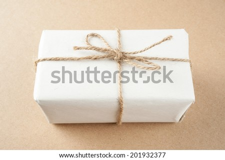 isolated gift box on cardboard