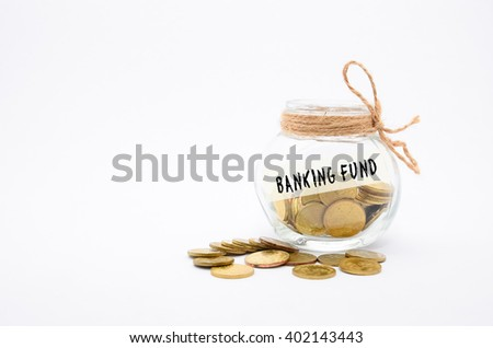 Isolated gold coins in jar with Banking Fund label - financial concept