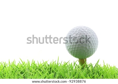 isolated golf ball on pin over green grass with white background