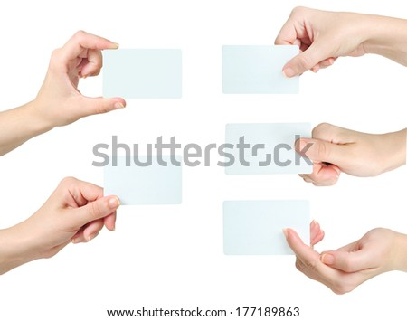 Isolated hand holding business card