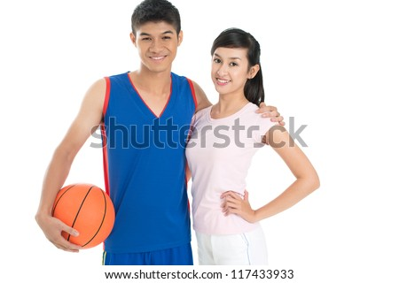 Isolated image of cheerful basketball players posing for the camera