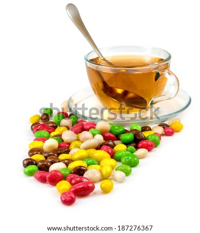Isolated image of colorful sweets and a cup of tea