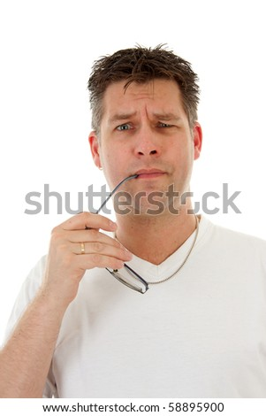 isolated man in white t-shirt is holding glasses in mouth