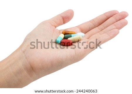 Isolated of Hand holding a pill capsule.
