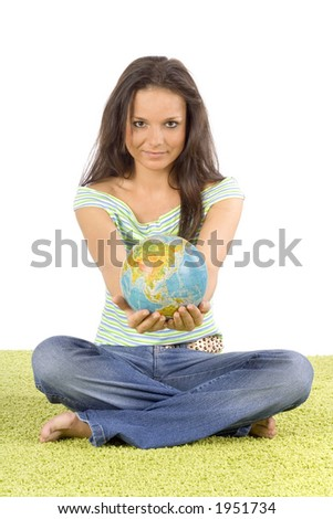 isolated on white woman sitting on the green carpet - giving globe