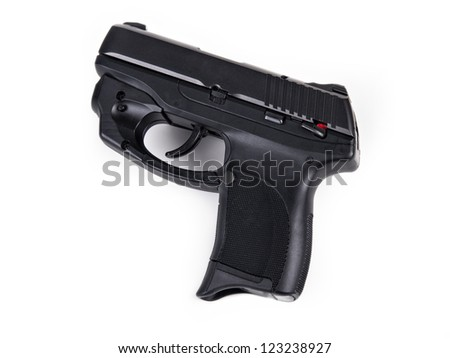 Isolated photo of a 9mm handgun with Laser