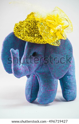 Isolated picture of Elephant toy with yellow hat