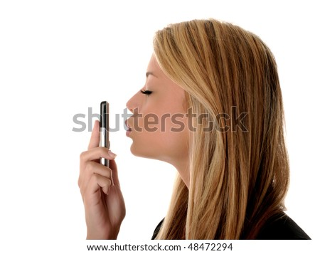 Isolated portrait of a girl kissing her phone