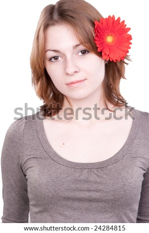 isolated portrait of a woman with gerber flower