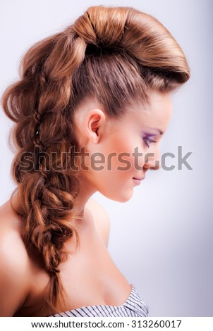 isolated portrait sideview of blonde young girl in elegant whimsical coiffure with sad grey eyes and naked shoulders