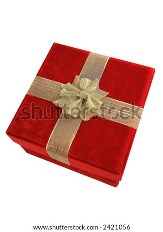 Isolated red velvet gift box with gold ribbon
