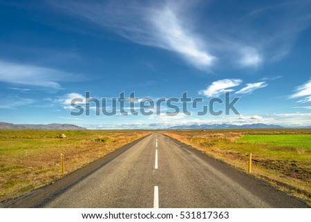 Isolated road and Icelandic landscape at Iceland, summer time