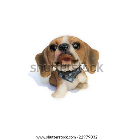 Isolated statuette of small funny dog