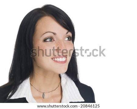 Isolated studio headshot of a businesswoman smiling while looking away.
