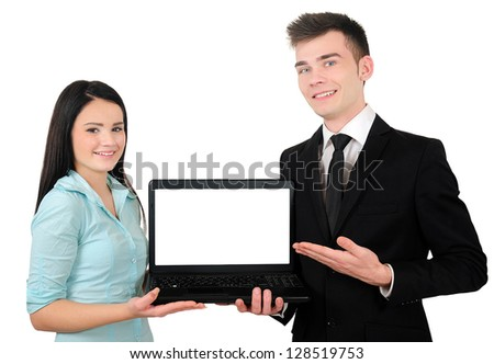 Isolated young business couple presenting laptop