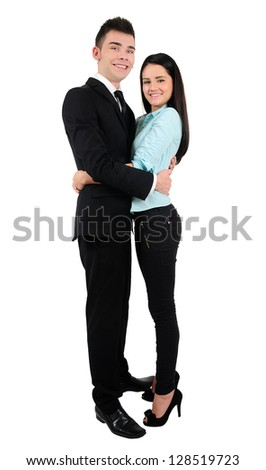 Isolated young business couple standing