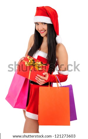 Isolated young christmas girl with shopping gift