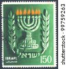 """ISRAEL - CIRCA 1955: An used Israeli postage stamp issued in honor of the Hanukkah celebration showing seven branched menorah with inscription """"Israel""""; series, circa 1955 - stock photo"""