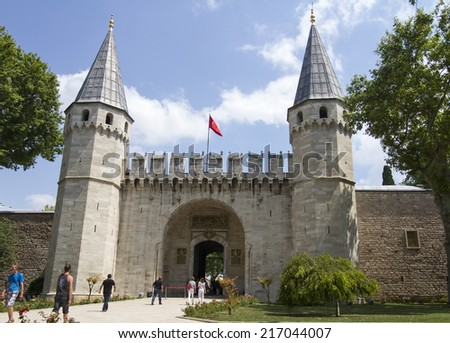 ISTANBUL - JULY 5: Tourists near the main gate of Topkapi Palace on July 5, 2014 in Istanbul.