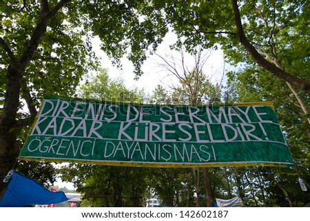 ISTANBUL - JUNE 15: Banner in Gezi Park during protests on June 15, 2013 in Istanbul, Turkey. Police evacuated Gezi Park by using disproportionate force and clashes until dawn.