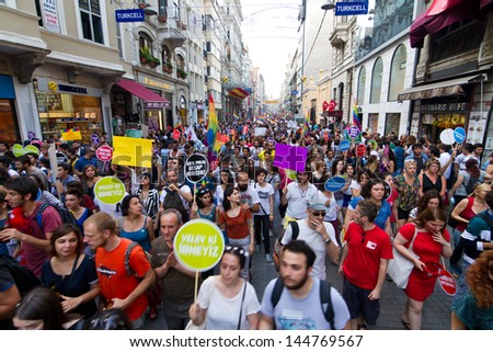 ISTANBUL - JUNE 30: People in Istiklal Street for LGBT pride parade on June 30, 2013 in Istanbul, Turkey. Almost 100.000 people attracted to pride parade and the biggest pride ever held in Turkey.