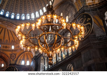 ISTANBUL - OCTOBER 25, 2013:  Interior chandelier of Hagia Sophia (Ayasofya) in Istanbul Turkey. The museum was formerly basilica and mosque before being designated museum in 1933.