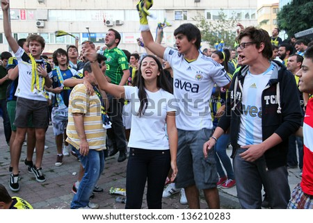 ISTANBUL, TURKEY - AUGUST 29: Fenerbahce fans having fun before the game against Panathinaikos for UEFA Champions League qualifying round match at around Kadikoy on August 29, 2012 in Istanbul, Turkey
