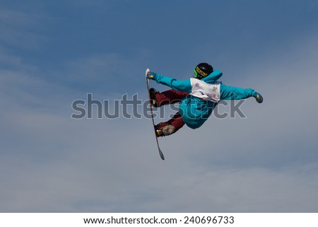 ISTANBUL, TURKEY - DECEMBER 20, 2014: Cheryl Maas jump in FIS Snowboard World Cup Big Air. This is first Big Air event for both, men and women.