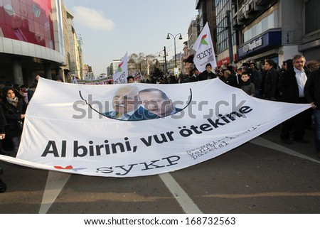 "ISTANBUL,TURKEY-DECEMBER 22:Thousands protest against corruption and government on December 22, 2013 in Istanbul, Turkey.A banner with F.Gulen and PM's pictures reads ""one is no better than the other"""