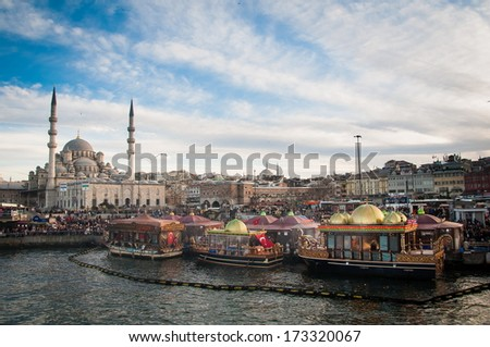 ISTANBUL, TURKEY - FEBRUARY 03, 2013: Fish sandwich shop boats next to a famous mosque of Istanbul.