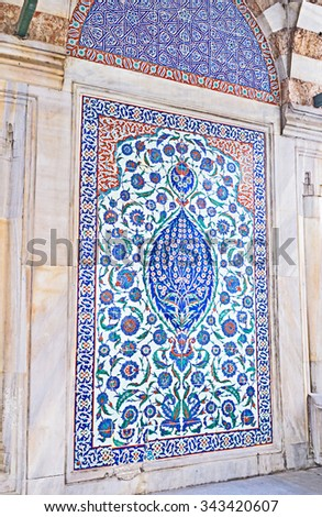 ISTANBUL, TURKEY - JANUARY 13, 2015: The tiled panel on the facade of Tomb of Sultan Selim II with the colorful flower pattern, on January 13 in Istanbul.