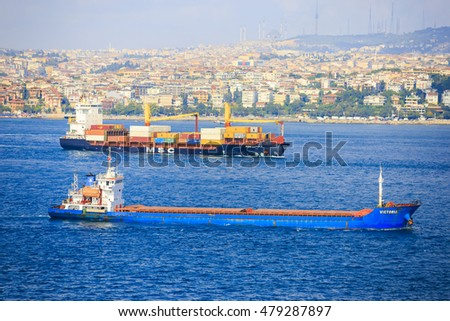 Istanbul, Turkey - July, 30 2016: Cargo freight ship passing through to Istanbul Bosphorus