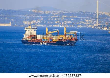 Istanbul, Turkey - July, 30 2016: Container ship passing through to Istanbul Bosphorus