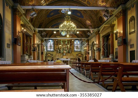 ISTANBUL, TURKEY - JULY 13, 2014: The interior of Saint Mary Draperis Church. It is the most ancient Roman Catholic Church built  in neoclassical style on Istiklal Street. Istanbul, Turkey.