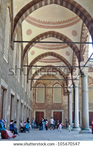 ISTANBUL, TURKEY - JUNE 03: Tourists in the courtyard of Sultanahmet Mosque on June 03, 2012 in Istanbul, Turkey. This is the biggest mosque in Istanbul of Sultan Ahmed is a great tourist attraction.