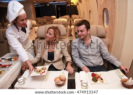 ISTANBUL, TURKEY - OCTOBER 11: Flight attendants, before flight, proofing services to passengers in the airplane on October 11, 2013 in Istanbul, Turkey.