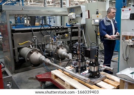 ISTRA, RUSSIA 2012 APRIL 10: GRUNDFOS factory. Personnel testing a water pump under high pressure