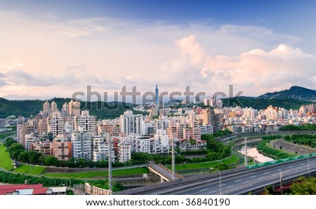 It is a cityscape photo of apartments and highway.