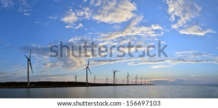 it's a panorama wind-power station with clouds and blue sky