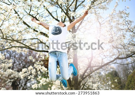It's summer, it is fun :) A child jumps high in the spring morning  (Print on T-shirt own)